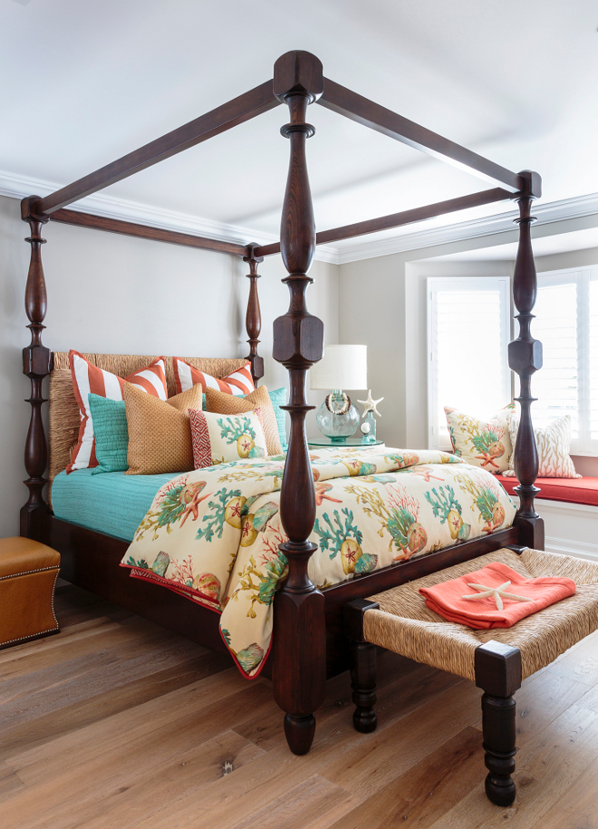 In this bedroom, a tropical coastal color palette contrasts beautifully against soothing wall color and matte wide plank floors. Barclay Butera Interiors.