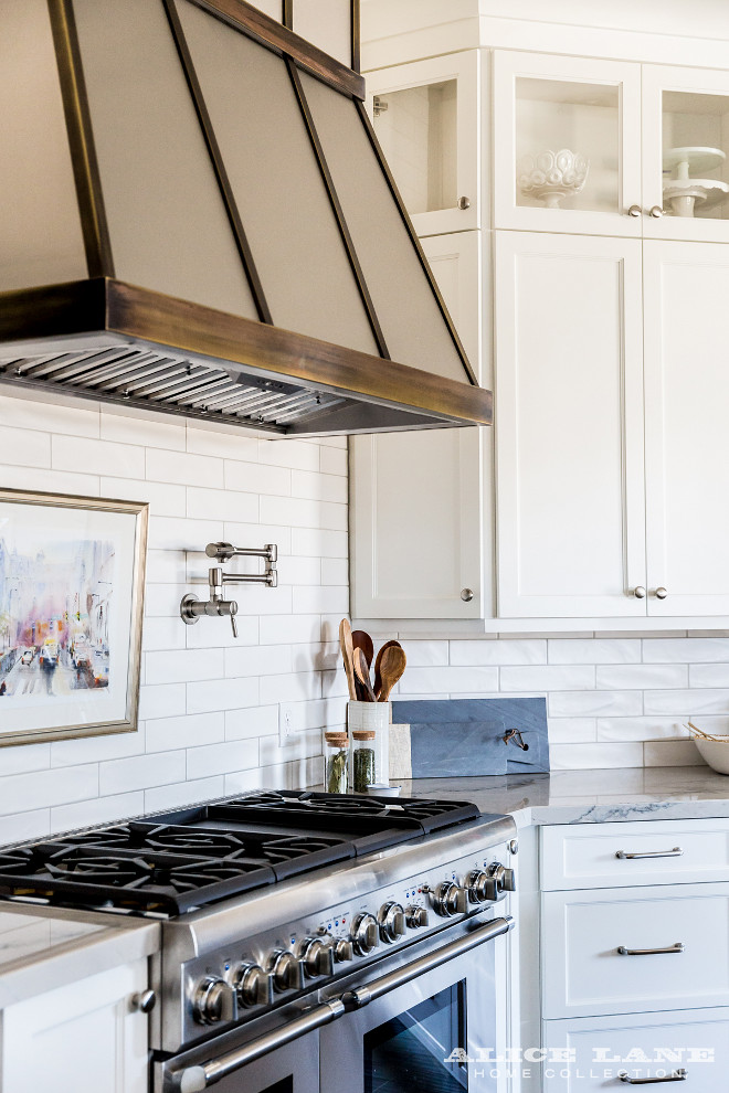 Zinc and aged brass kitchen hood. Kitchen hood. Zinc and aged brass kitchen hood with white backsplash tile and white cabinets. #Zinchood #agedbrasskitchenhood #kitchenhood Alice Lane Home.
