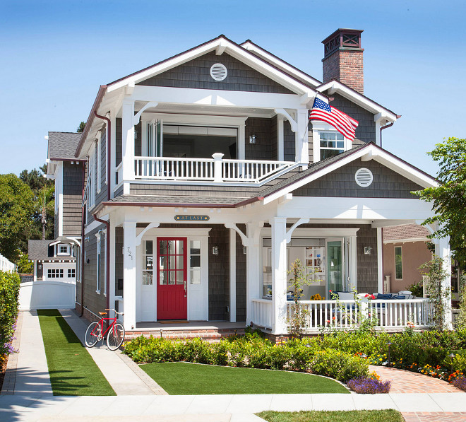 American Flag Porch Ideas. Coastal home with American Flag, Porch. American Flag front of house with a red front door to match. Americana. #AmericanFlag #Porch #RedDoor #FrontDoor #Facade Flagg Coastal Homes
