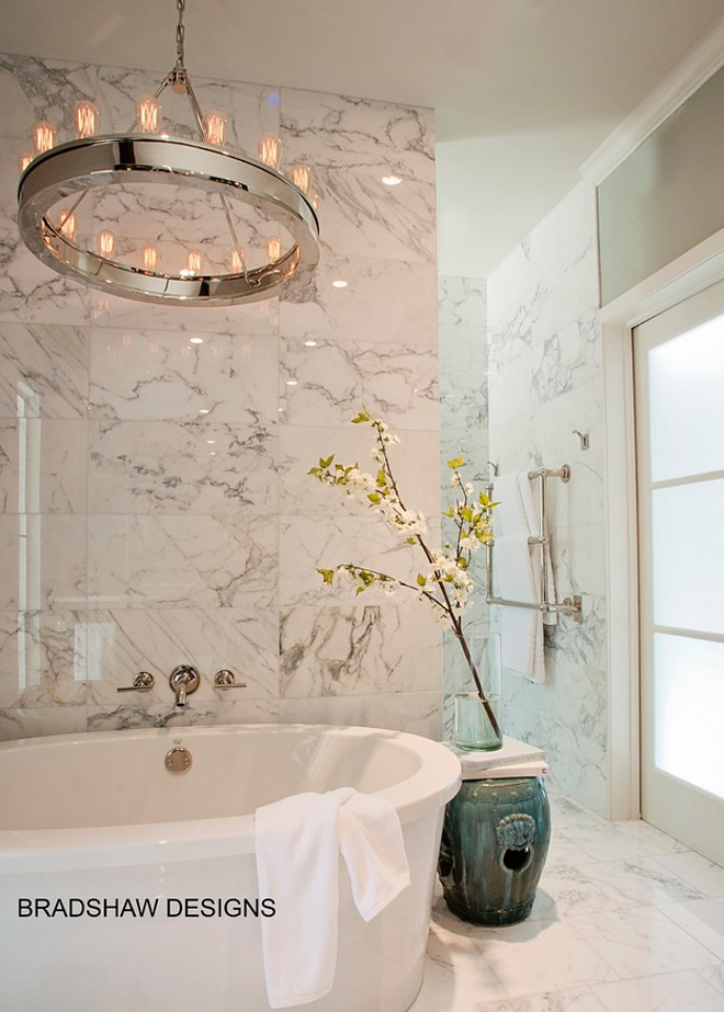 Bathroom lighting. Bathroom with lighting above tub. Bathroom lighting. Lighting above tub is Ralph Lauren Roark Modular Ring Chandelier in Polished Nickel. #RalphLauren #RoarkModular #RingChandelier #PolishedNickel