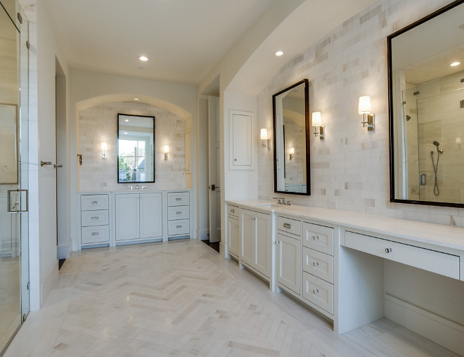 Bathroom with vanities tucked into arched nooks and herringbone marble floor tiles. Bathroom with vanities tucked into arched nooks and herringbone marble floor tiles #Bathroom #vanities #archednooks #herringbonetile #marblefloortiles Robert Elliott Custom Homes