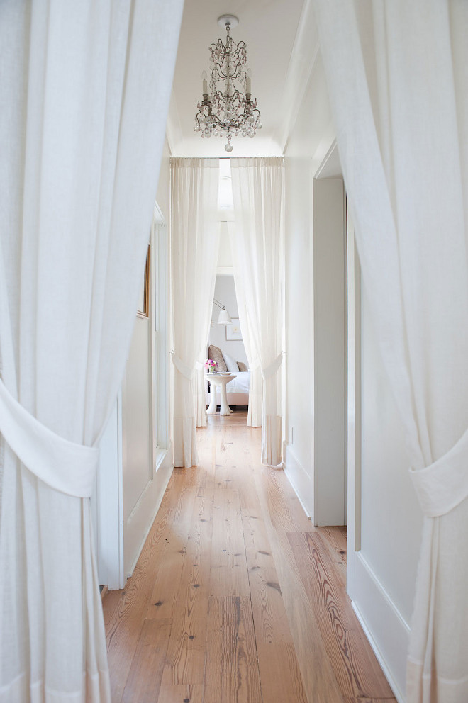 Bedroom entry. Master bedroom entry. Bedroom entry. A hallway to bedrooms is finished with white curtains and tie backs in lieu of doors illuminated by a crystal chandelier. Bedroom entry #Bedroomentry #MasterBedroomentry #bedrooms Smith Hanes