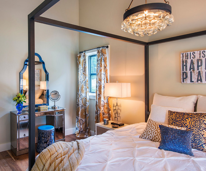 Bedroom lighting. Four poster bed lighting. Bedroom lighting. Chandelier is from Currey & Co. #Bedroom #lighting Caldwell & Johnson Custom Builders & Remodelers