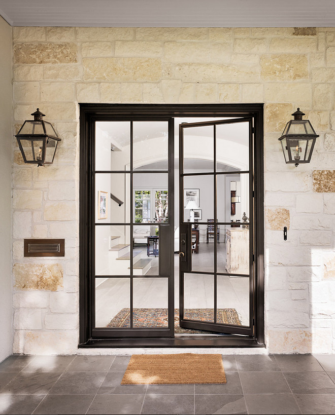 Black Steel Front Door. Front entry with black steel door, stone walls and Bluestone floor tile. Black Steel Front Door. Steel Front Door. Black Steel #BlackSteelDoor #Frontdoor #BlackSteelDoor #SteelDoor