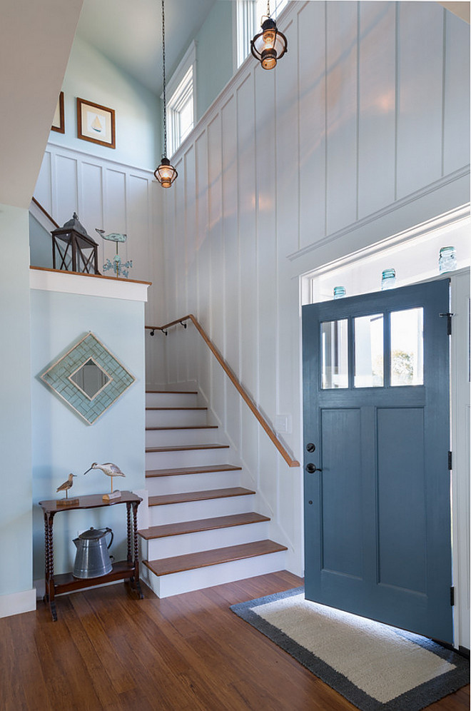 "Board and batten foyer. A foyer with board and batten walls, painted in ""Benjamin Moore OC-17 White Dove"", immediately makes you feel welcome and relaxed. Board and batten foyer wall. Board and batten foyer accent wall. Board and batten foyer staircase. #Boardandbatten #foyer #Boardandbattenwall #Boardandbattenfoyer #Boardandbattenstaircase"