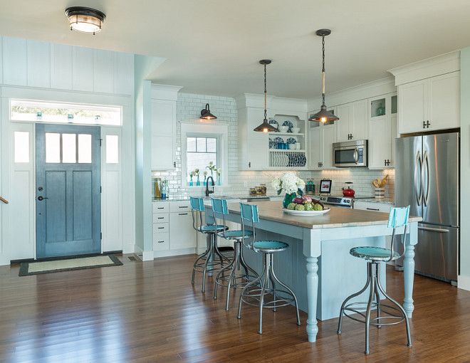 Coastal kitchen with blue gray kitchen island, off-white cabinets and turquoise barstools. Coastal cottage kitchen with blue gray kitchen island, off-white cabinets and turquoise barstools. #Coastalkitchen bluegray #kitchenisland #offwhitecabinets #turquoisebarstools