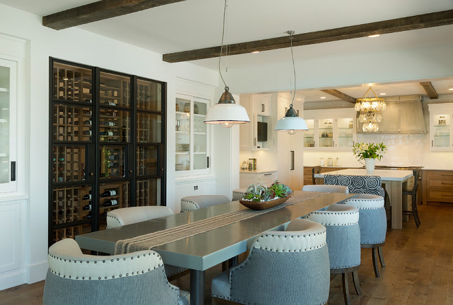Dining room wine cellar with black steel doors. Dining room wine room with black steel doors and built in cabinets on both sides. Dining room wine cellar with black steel doors. #Diningroom #winecellar #wineroom #blacksteeldoor