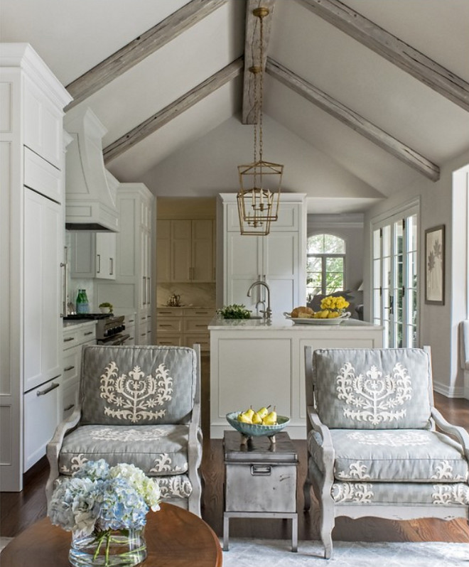 Remodeled White Kitchen with Vaulted Ceiling Beams Home