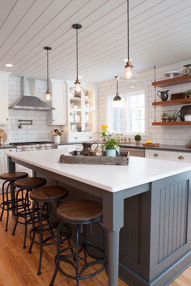 Farmhouse kitchen with shiplap plank ceiling and beadboard island painted in a dark grey. Farmhouse kitchen island paint color is Storm Gray in Dura Supreme. #Farmhousekitchen #kitchen #farmhousestyle #farmhousekitchen Advance Design Studio, Ltd.