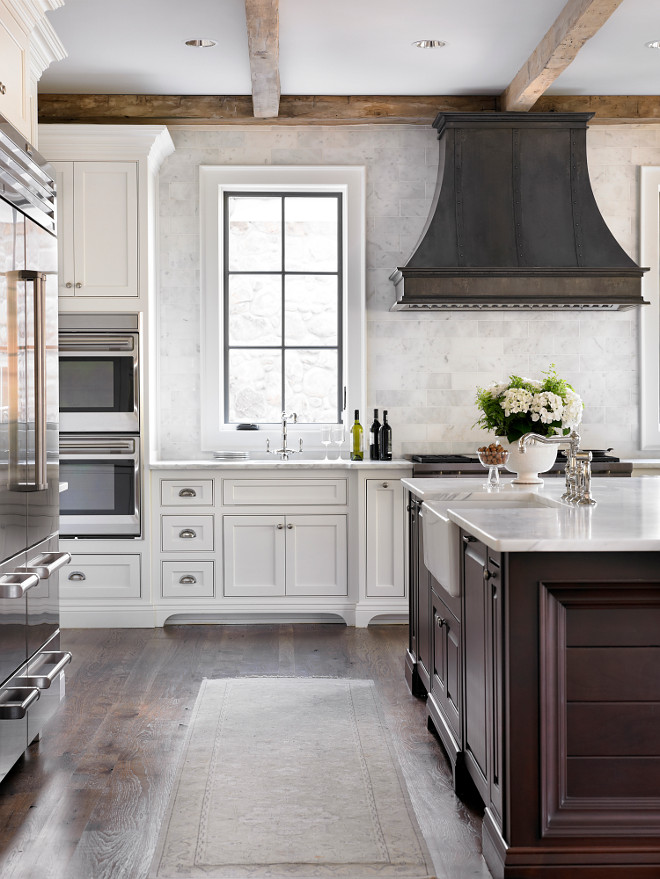 French Country kitchen with reclaimed wood beams and zinc French kitchen hood. Beautiful French Country kitchen with reclaimed wood beams and zinc French kitchen hood #FrenchCountry #kitchen #FrenchCountrykitchen #reclaimedwood #beams #zincFrenchhood #kitchenhood L. Kae Interiors