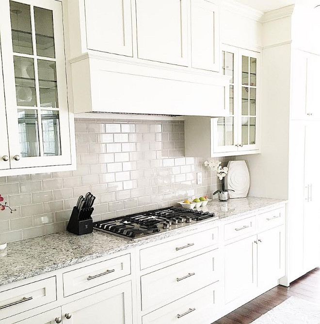 Grey backsplash tile. Grey backsplash tile in creamy white kitchen. Grey backsplash tile is Casabella Tile H-Line Collection color Pumice. #Greybacksplashtile