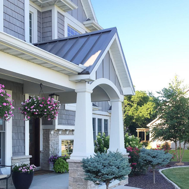 Home exterior. Porch. Front Porch with Portico. Home exterior. Porch. Front Porch with Portico, tappered column, grey shingles, grey stone, white trim #Homeexterior #Porch #FrontPorch #Portico #tapperedcolumn #greyshingles #greystone #whitetrim Beautiful Homes of Instagram carolineondesign