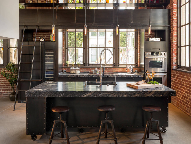 Industrial kitchen countertop and steel cabinets. Industrial Kitchen Steel Cabinets: According to the designer, the homeowner didn't want solid metal cabinets that would create a clanging racket every time he dropped a piece of silverware into a drawer or shut a cabinet. So Bayon's firm designed and built wood cabinets, then had another company, Berlin, fabricate steel panels to cover everything. The countertops are Silver Brown Wave marble. #Industrialkitchen #steelcabinet #steelcabinets #countertop #SilverBrownWave #marble Muratore Construction + Design