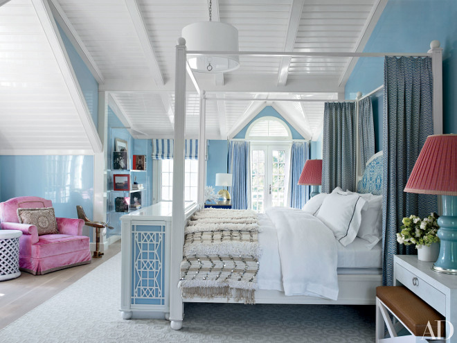 Interior decorator Christopher Maya designed the bed and television cabinet at its foot in a guest room at the Hamptons home of entrepreneur J. Christopher Burch. A China Seas fabric sheathes the walls; the bedding is by Matouk, the lamps are from Treillage, and the carpet is by Merida Meridian. Architectural Digest.