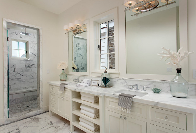 Ivory white bathroom with marble countertop and marble floor tiles. Ivory white bathroom with marble countertop and marble floor tile. #Ivorywhitebathroom #Ivorywhite #bathroom #marble #countertop #marbletile #floortiles Blackband Design