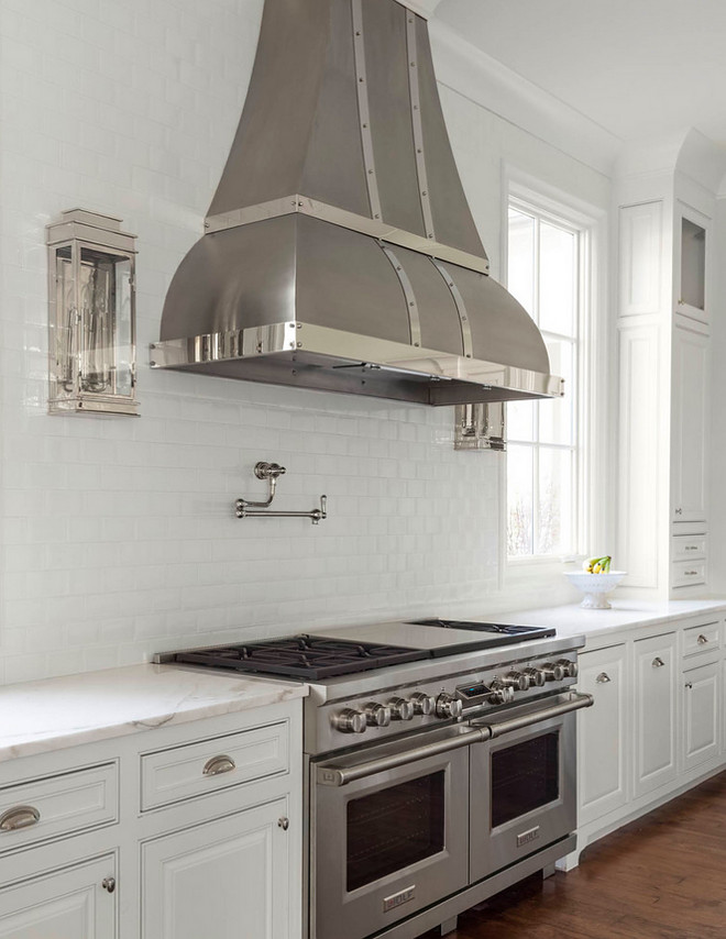Kitchen sconces. Kitchen sconces on both sides of kitchen hood. Kitchen sconces. Kitchen sconces on both sides of kitchen hood. #Kitchensconces #Kitchen #sconces #hood Robert Elliott Custom Homes