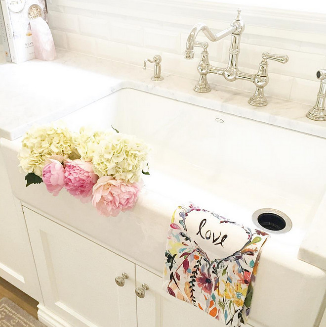 Kitchen sink decor. Peonies and dish towel from Anthropologie. #kicthen  #sink  jshomedesign