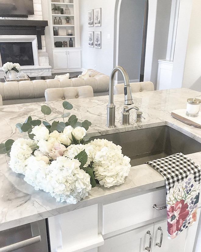 Kitchen stainless sink. Beautiful kitchen island with quartzite countertop and stainless sink. Kitchen island stainless steel sink. #stainlesssink #kitchenisland #quartzite #countertop #stainlesssteelsink