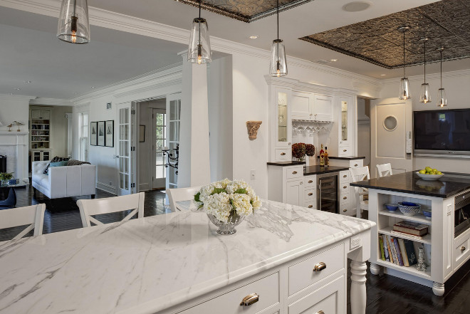 Kitchen with double islands. Calcutta gold marble and Maroon cohiba antique granite are used as countertop in this kitchen with double islands. Jane Kelly, Kitchen and Bath Designer