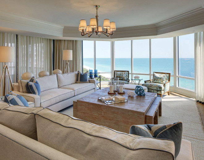 Living room with sheer draperies. Gorgeous oceanfront living room with sheer draperies and Ralph Lauren woven sea grass table. #livingroom #oceanfront #sheerdraperies