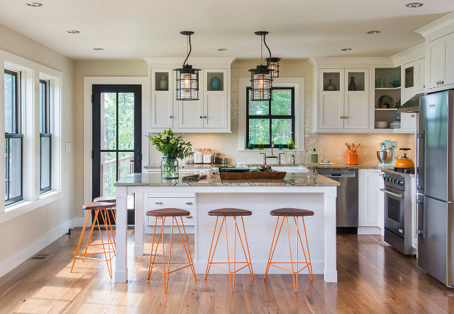 Modern Farmhouse Ivory white kitchen. Modern Farmhouse Ivory white kitchen with wide plank floors, black frame windows and neutral wall paint color. The kitchen inset cabinets are from Starmark in Marshmallow Cream. Modern Farmhouse Ivory white kitchen #ModernFarmhouse #Ivorywhite #kitchen #ModernFarmhouse #Ivorywhite #kitchen #farmhousekitcheninsetcabinet #insetcabinet Caldwell & Johnson Custom Builders & Remodelers
