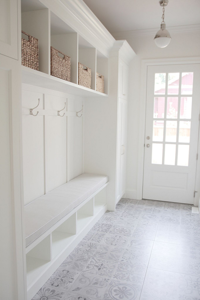 Mudroom with cement tile. White Mudroom with light grey cement tile. Everything was impeccably designed in this mudroom, but what really catches your attention is the cement flooring. Mudroom with cement tile. #MudroomcementTile #Mudroom #cementTile jshomedesign