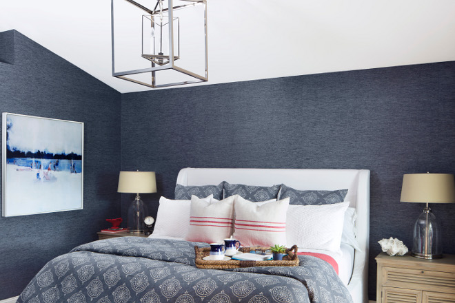 Navy wallpaper. Bedroom navy wallpaper. Adding a navy wallpaper in a bedroom creates coziness. The master bedroom features a navy wallpaper; a Phillip Jeffries Blue Barogues wallpaper, which beautifully contrasts with a white upholstered bed. #Navywallpaper #navy #wallpaper #bedroom Lisa Michael Interiors