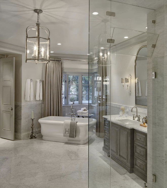 Pale grey bathroom. Pale grey bathroom with greywash cabinet. Pale grey bathroom with marble flooring and marble wall tile. Pale grey bathroom #Palegrey #bathroom Candelaria Design Associates