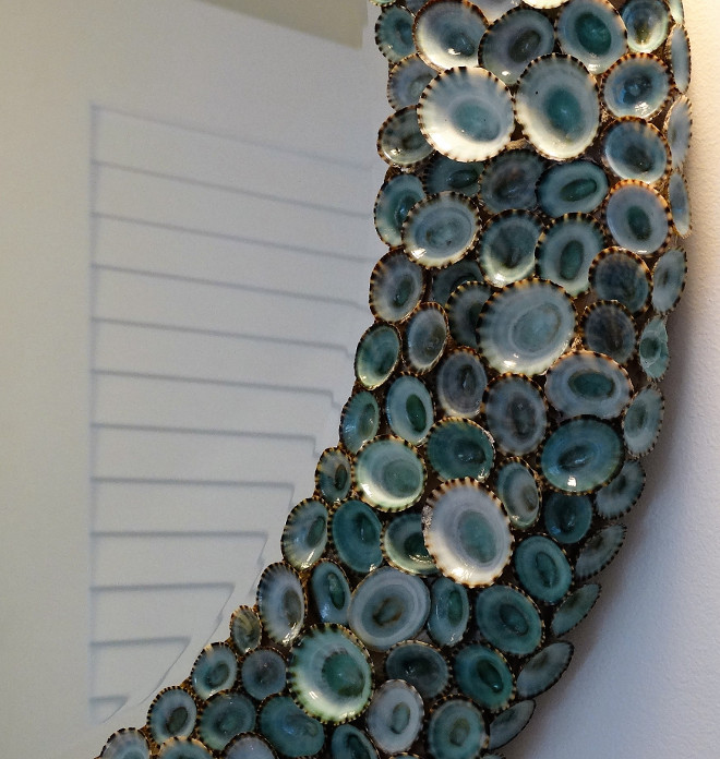 Shell Mirror. The guest bathroom features a shell mirror - Blue Limpet Shell Mirror by Karen Robertson - $1,625.00. Flagg Coastal Homes.