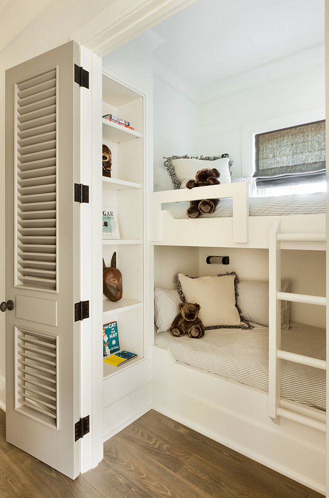 Small Bunk Room. Smartly designed small bunk room with bookcase for extra storage and louvered doors to add privacy. Small Bunk Room #SmallBunkRoom #BunkRoom Beth Webb Interiors