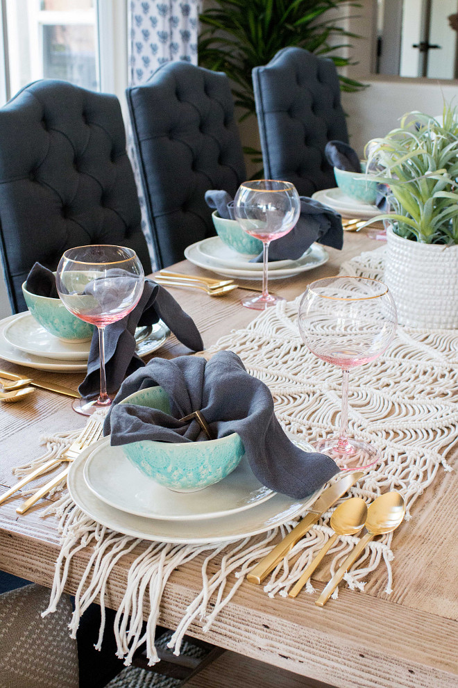 Table Setting Tips. Look for textures and tones around the room that you can incorporate into your table setting. We played off the navy dining chairs and brought in solid, charcoal napkins to add another layer of depth on the table. We used brass napkin rings to play off the silverware and keep things clean and consistent. Table Setting Tips #TableSetting #Tips