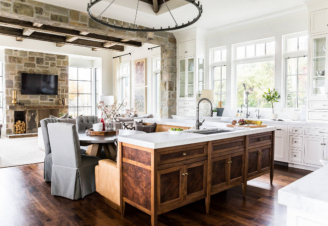 The Kitchen cabinetry was designed to embrace the natural light in Bespoke white style, countered by the natural burled Maple & Walnut island - designed in the inlaid 'Biedermeier' tradition - to give added warmth to the leather banquette. Hyrum McKay Bates Design, Inc.