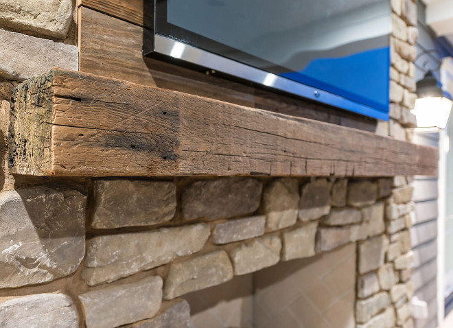The backyard living space has a reclaimed wood accent wall above the reclaimed wood mantel. The ADDRESS Company