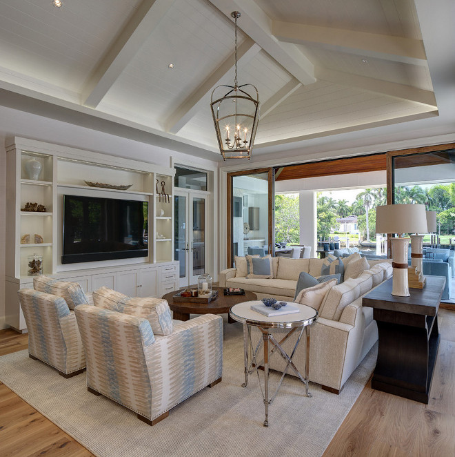 Vaulted shiplap ceiling. Transitional coastal living room with vaulted shiplap ceiling. Beautiful Transitional coastal living room with vaulted shiplap ceiling. #Transitionallivingroom #coastallivingroom #vaultedceiling #shiplapceiling #shiplap W Design Interiors
