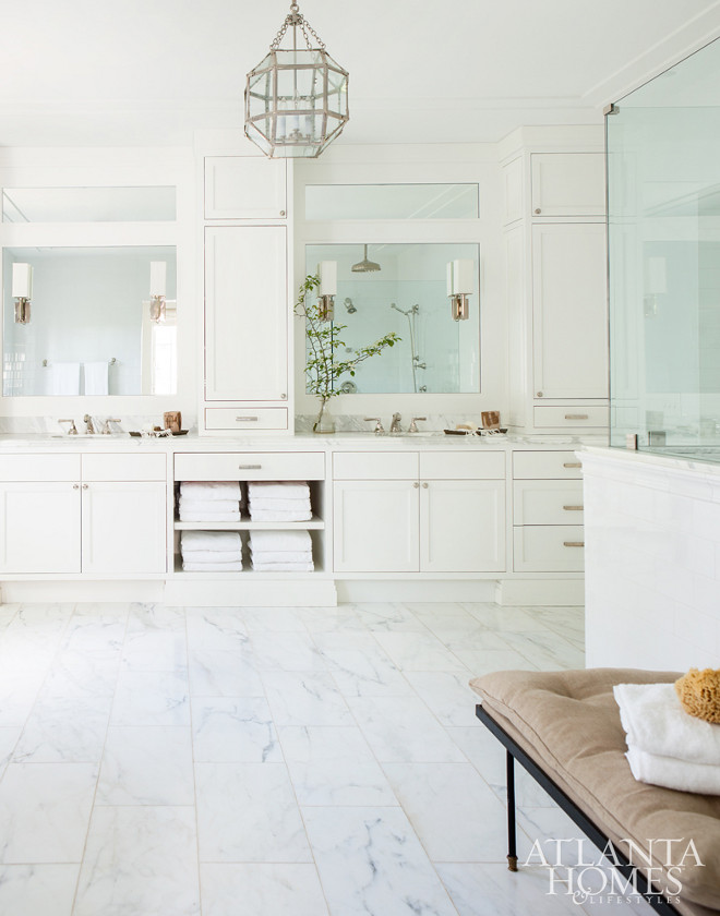 White bathroom. Off-white bathroom. Beuatiful Off-white bathroom with marble flooring, Morris pendant light and large cabinets with double sinks. #whitebathroom #offwhitebathroom #bathroom #white #morris #lighting Scout for the Home for Atlanta Homes Magazine.