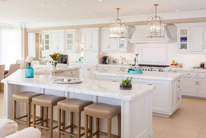 White kitchen with beige walls. Beautiful White kitchen with beige walls and two islands. White kitchen with beige walls. #Whitekitchen #beigewalls Monarch Development and Design