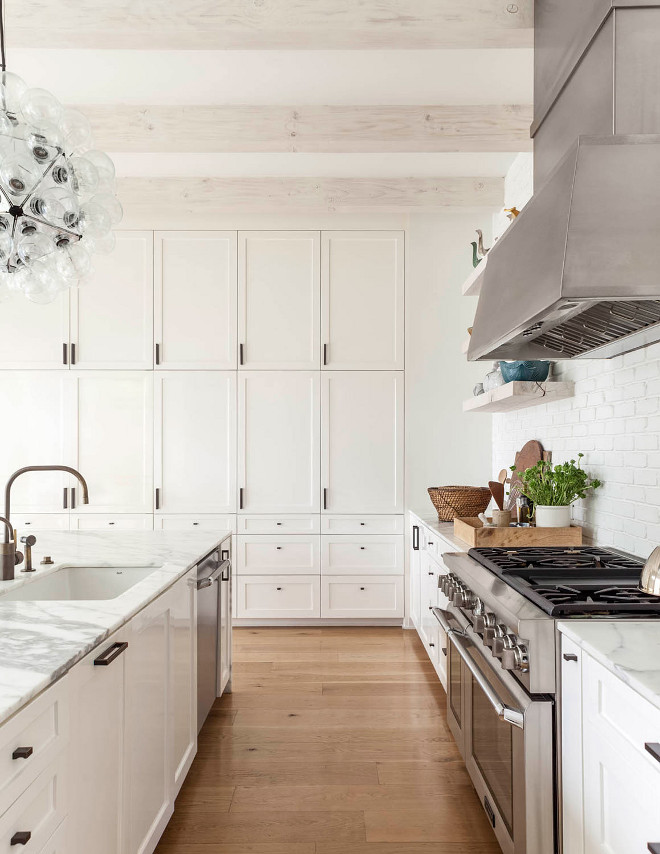 White kitchen with whitewashed ceiling beams. Crisp White kitchen with whitewashed ceiling beams. White kitchen with whitewashed ceiling beams #Whitekitchen #whitewashedbeams #ceilingbeams #whitewashedceilingbeams Robert Elliott Custom Homes