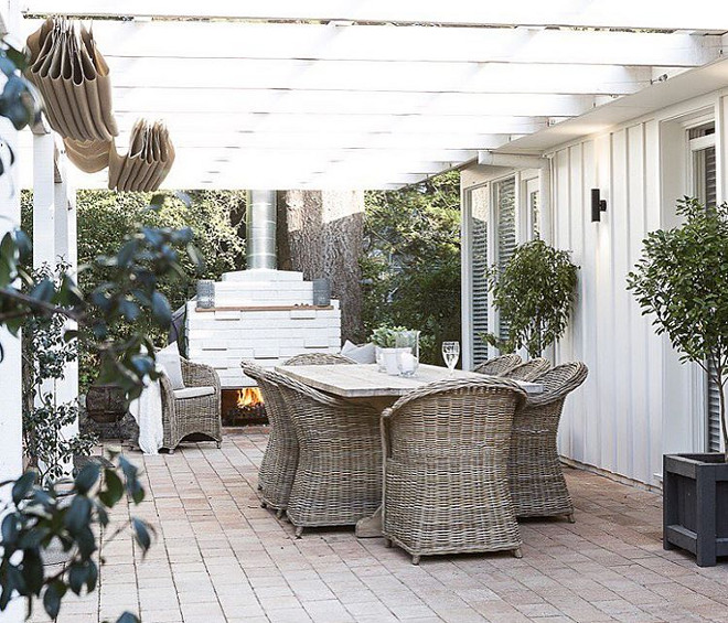 Pergola. White pergola. Wicker furniture constrasts againts the Pergola. #Pergola #whitepergola Cottonwood Interiors