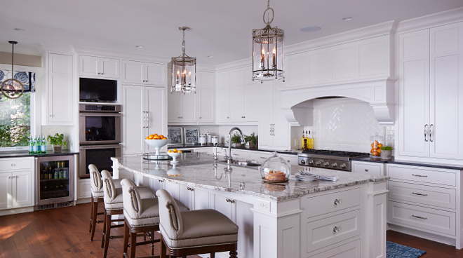 White kitchen. This white kitchen features a timeless design that will stand the test of time. The backsplash is custom hand-made crackle tiles from Sonoma Tile Makers. #kitchen #whitekitchen Vivid Interior Design. Hendel Homes