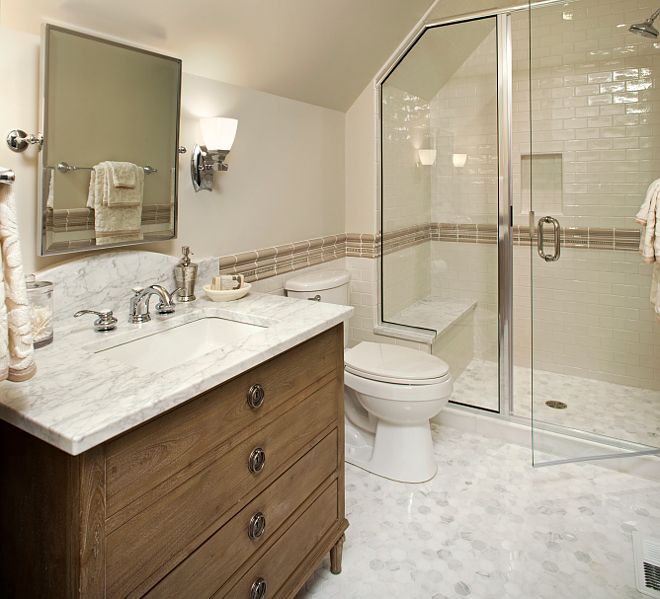 "Bathroom Piant color and flooring. Paint color is Benjamin Moore Baby Fawn OC-15. The ceiling color is 50% white/50% Linen White 912. The floor is a statuary white marble 2x2"" hexagon tile. The wall is a 2.5x5"" white glazed ceramic tile and the chair rail tile is an ecru raised deco tile and pencil liner. 50-linen-white-912 Vivid Interior Design. Hendel Homes"