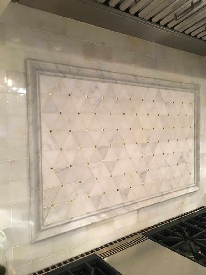Backsplash above range. Above range backsplah. The backsplash is framed with Honed Carrara Marble Border. #backsplash #HonedCarraraMarble #backsplashBorder Beautiful Homes of Instagram Sumhouse_Sumwear
