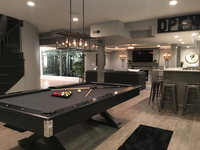 Basement Pool Table/Ping Pong Conversion table and Dart Board: Jaxxon Game Table by American Heritage. Pool table light fixture is by Trans Globe. Beautiful Homes of Instagram Sumhouse_Sumwear