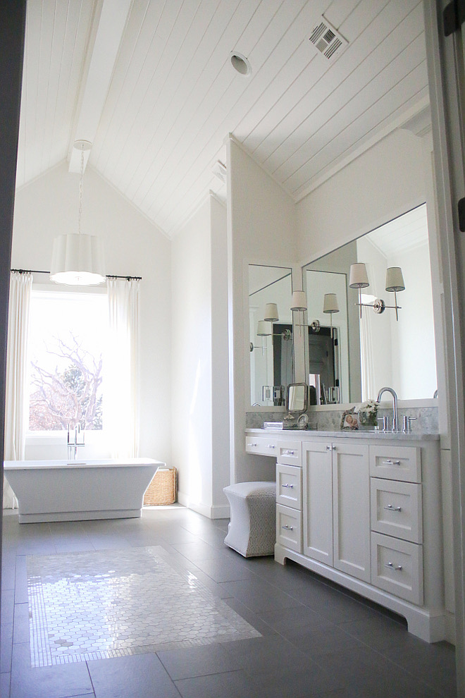 If I had to choose a favorite room in our home, this is probably it. I was so into the shiplap look and it was starting to become more and more popular. We decided to put it on the ceilings and vault the ceiling for a show stopping statement when you walk into the room. The freestanding tub is like art and the pendant above it is truly beautiful in person. All white makes it so light and airy. The tile rug was a in touch made from marble hexagon tiles and a marble mosaic border #bathroom #ceiling #shiplap bathroom-ceiling Home Bunch's Beautiful Homes of Instagram curlsandcashmere