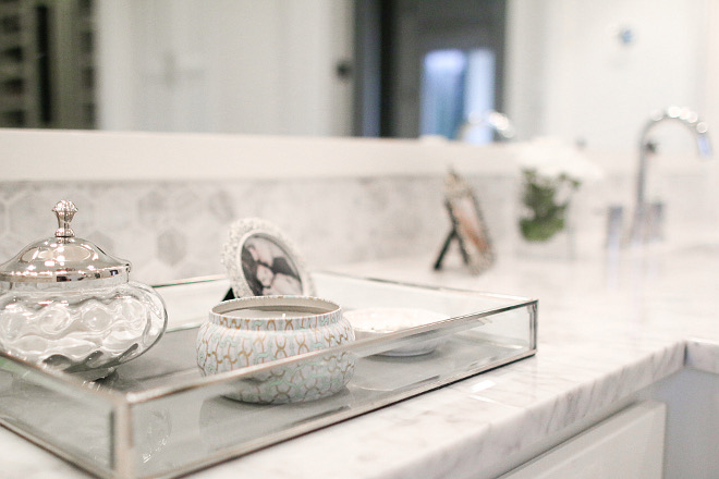 The bathroom decor is elegant and neutral. bathroom-tray-decor Home Bunch's Beautiful Homes of Instagram curlsandcashmere