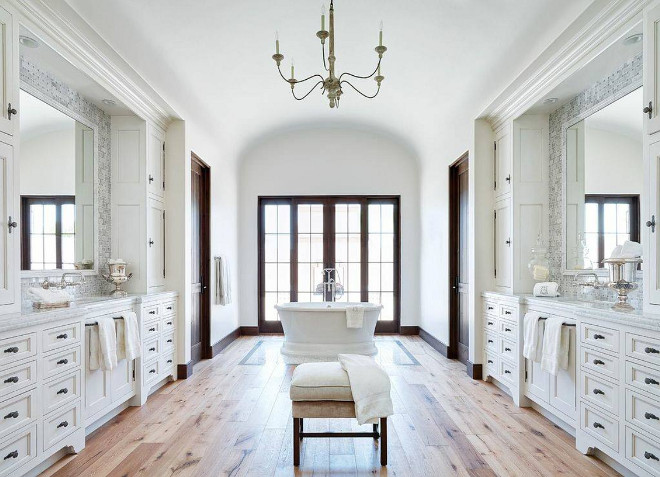Bathroom Wood Floor: The bathroom floor is a natural wood flooring from Premiere Wood Floors. bathroom-with-lots-of-cabinets-ached-ceiling-and-reclaimed-wide-plank-hardwood-floors