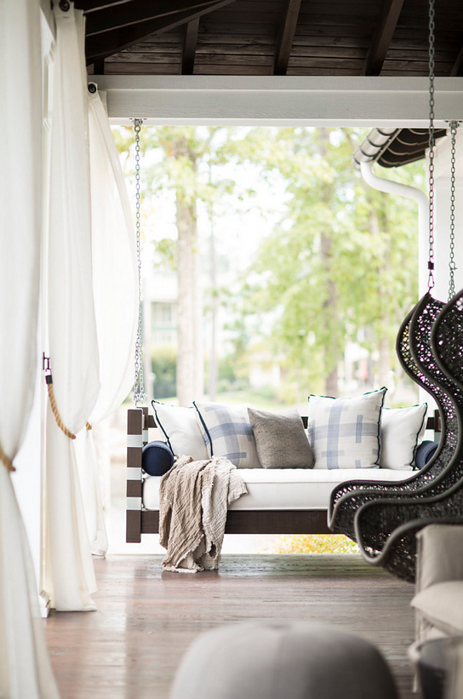 Bed swing. Porch bed swing and woven hanging chairs. Porch combination of bed swing and hanging chairs. #bedswing #hangingchairs Heather Garrett Design