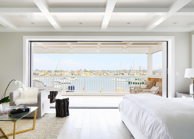 Bedroom Retractable sliding doors. Bedroom Retractable sliding doors open to a large covered balcony with sweeping views of the bay. Retractable sliding doors. #Bedroom #Retractableslidingdoors Winkle Custom Homes. Melissa Morgan Design. Ryan Garvin Photography