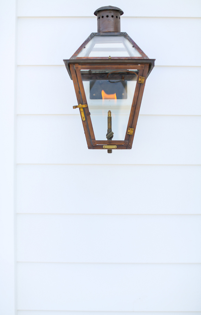 Bevolo Gas Lantern on White Siding. Exterior lights are Bevelo exterior gas lanterns. Exterior lights are Bevelo exterior gas lanterns. #Exteriorlights #Bevelo #exteriorgaslantern #gaslanterns #Exteriorlight Winkle Custom Homes. Melissa Morgan Design. Ryan Garvin Photography