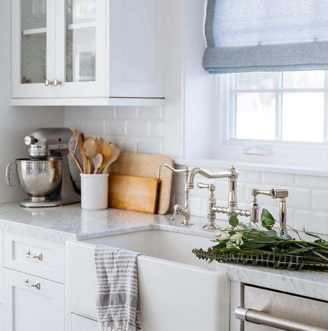 Carrara, Subway Tile and farmhouse sink. This combo never fails in a kitchen. #kitchen #carrara #subwaytile #farmhousesink Rita Chan Interiors