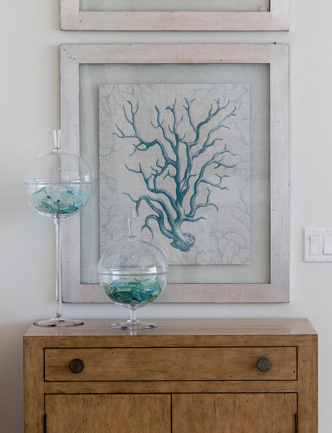 Coastal Foyer. Foyer coastal decor. A modern rustic feel is artfully implemented into a classic coastal design with natural distressed wood finishes. These prints were custom framed by Robb & Stucky.